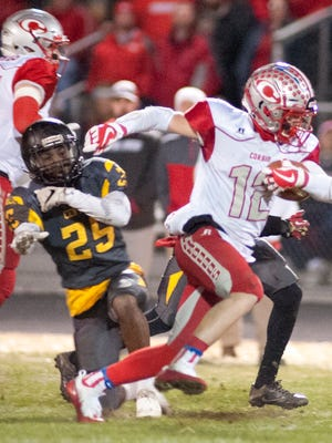 Corbin running back-wide receiver Chase Estep eludes the grasp of Central linebacker Durrell Howard Jr. in the Class 3A state semifinals at Central.  Nov. 24, 2017