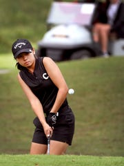 Central Magnet's Rachel Chan chips onto the green during last week's district tournament. Chan shot an 80 Monday in the region tourney to advance to state.
