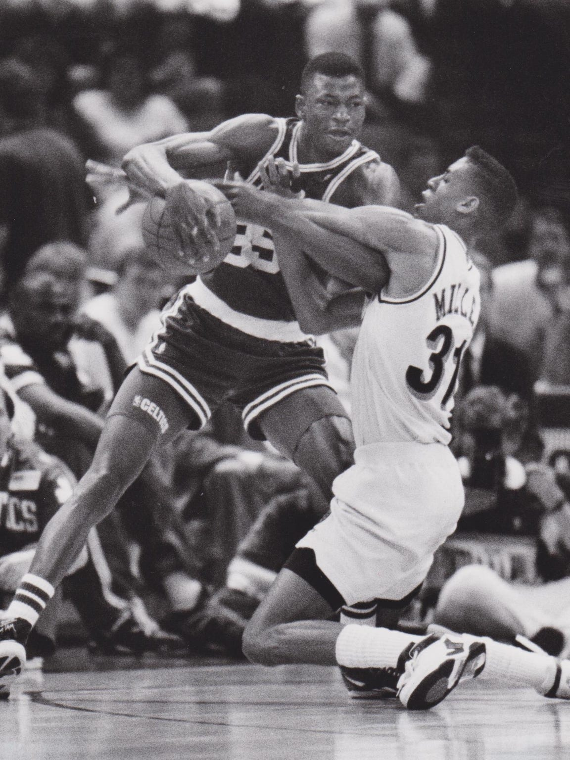 Reggie Miller, right, tries to strip the ball from