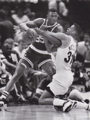 Reggie Miller, right, tries to strip the ball from Boston's Reggie Lewis.