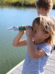 Katie Satery, 3, spends time at the UT Marine Science