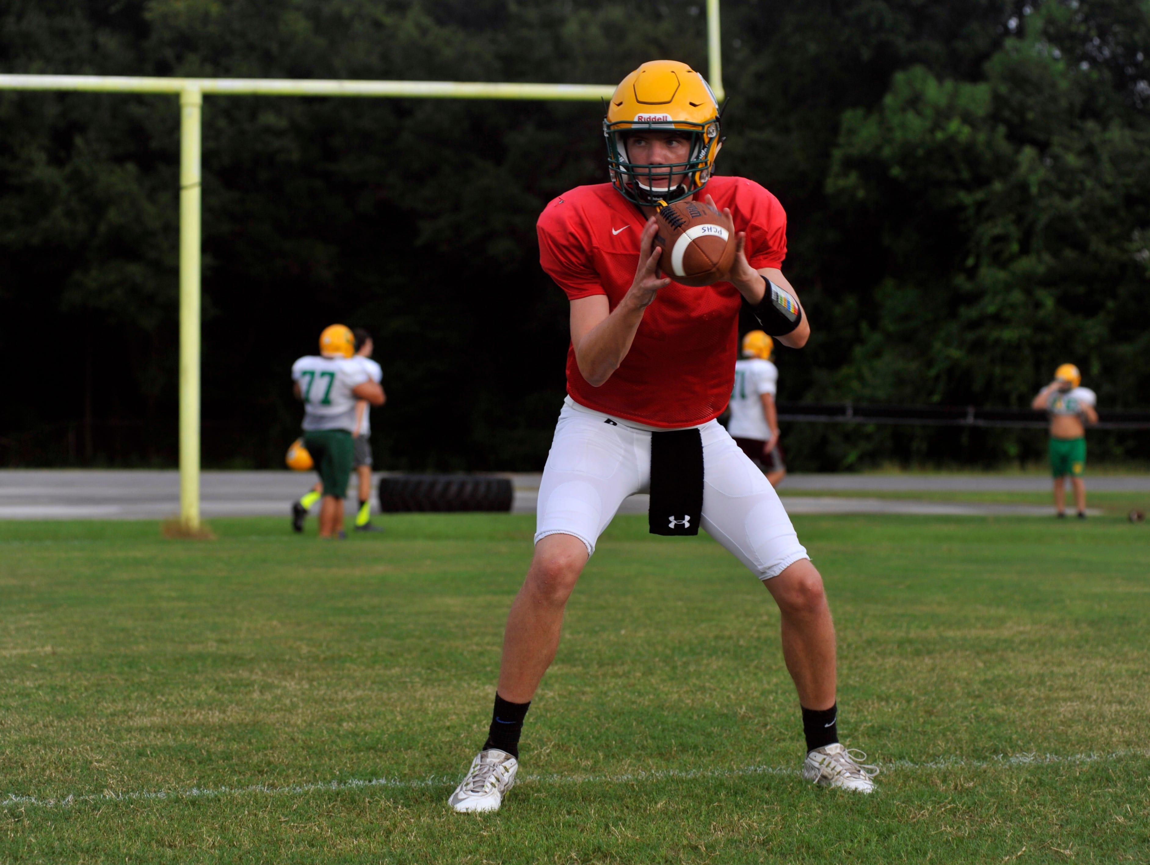 Pensacola Catholic quarterback Garrett Foley takes snaps during practice on Aug. 24, 2016.