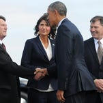 President Obama shakes hands with the Watertown Mayor Steve Thorson as U.S. Rep. Kristi Noem and U.S. Sen. Mike Rounds look on Friday. South Dakota's Republican delegation and the Democratic president put politics aside to enjoy the day in Watertown and Obama's first visit to South Dakota as president.