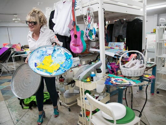 Leoma Lovegrove often uses trash can lids as her painter's palette.