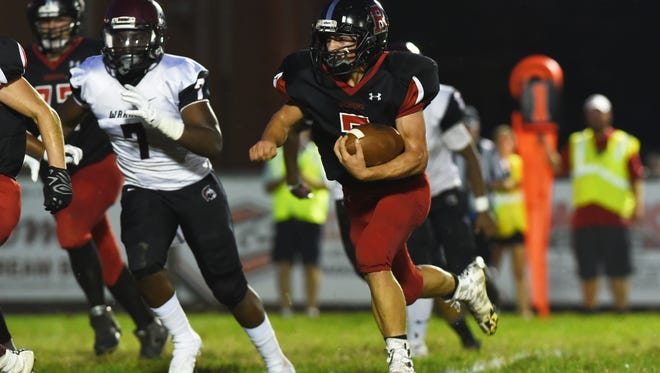 Rosecran's Carter Dosch carries the ball against Harvest Prep Friday night at Mattingly Family Field.