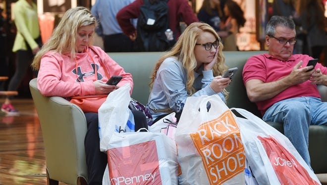 Cassey Sensat, left, and Hannah Frazier takes break from shopping at Cool Springs Galleria in Franklin, Tenn. in 2015.