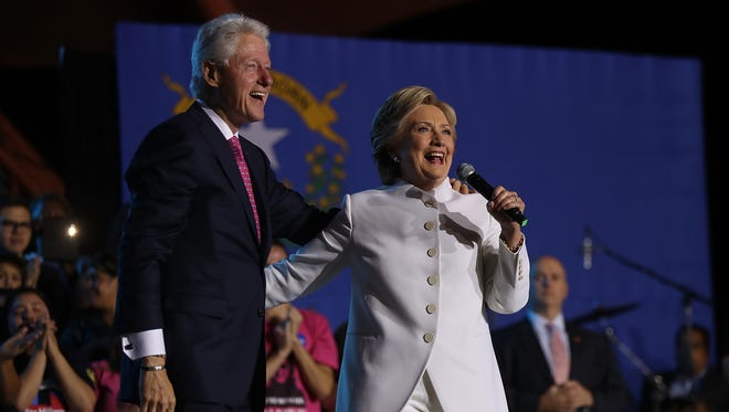 The Clintons speak during a debate watch party at Craig Ranch Regional Amphitheater following the third presidential debate at UNLV on Oct. 19, 2016, in North Las Vegas.