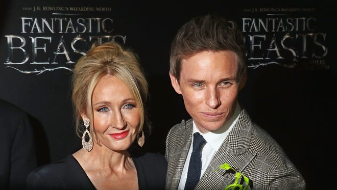Novelist J. K. Rowling and actor Eddie Redmayne attend the premiere of 'Fantastic Beasts and Where to Find Them' in New York City on Nov. 10.