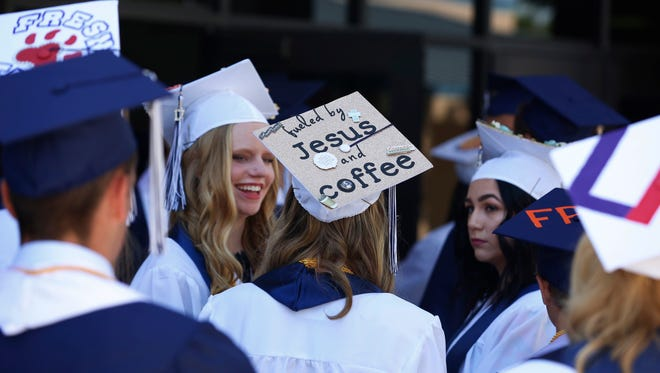 Kassidy Keeley's personal graduation note crafted onto her cap before graduating from Central Valley Christian High School Saturday, May 20, 2017 in Visalia, Calif.