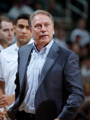 Michigan State coach Tom Izzo talks with an official