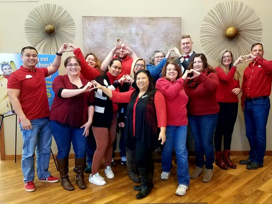 UnitedOne Credit Union's staff donated to the American Heart Associations' Go Red For Women effort on Feb. 2, 2018. UnitedOne's employees accounted for more than 500 hours of community service to over 25 local organizations in 2017.