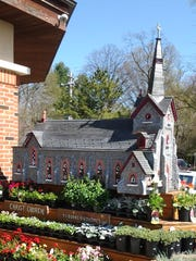 Thomas Burke's bird house creation of Christ Church Brandywine Hundred sits in front of Janssen's in Greenville.