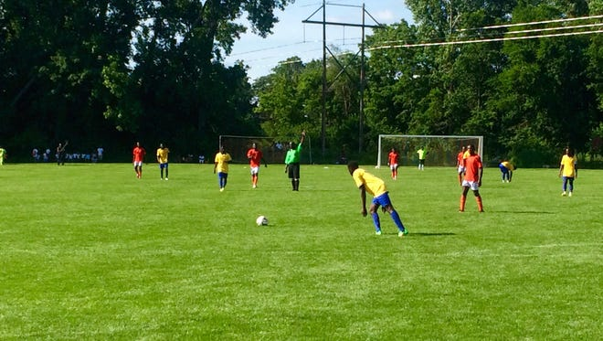 Immigrants from Africa and South America now living in Iowa and other parts of the country participate in the Genesis Midwestern Conference Cup soccer tournament June 21 in West Des Moines.