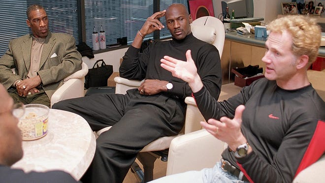 Michael Jordan and Tinker Hatfield, in a meeting in 1997, have been working with each other on the Air Jordan design since the 1980s.