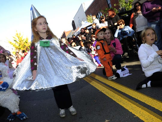 Riley Westbrook, 6, dresses as a Hersheys Kiss at PumpkinFest in Franklin