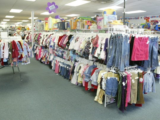 Clothes racks inside Once Upon A Child located at 1204 W. 86th Street in Indianapolis.