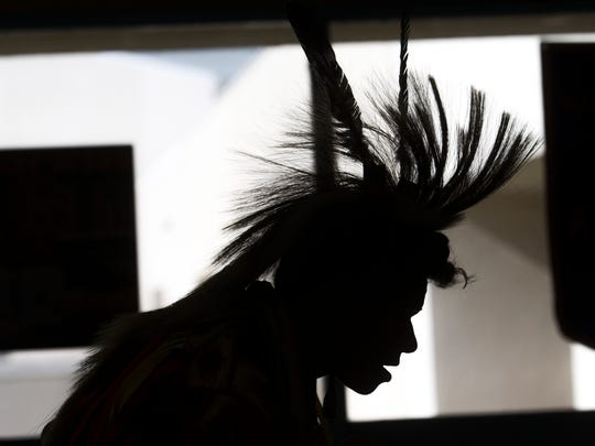 Anthony Hunt dances the grass dance, Monday, Oct. 9, 2017, during Indigenous Peoples Day celebrations at San Juan College in Farmington.