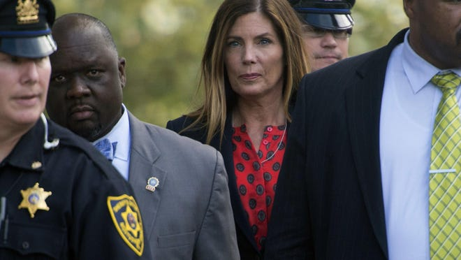 Pennsylvania Attorney General Kathleen Kane, center, leaves the Montgomery County courtroom where her trial for leaking grand jury testimony and then lying about it is underway, Wednesday. Aug. 10, 2016, in Norristown, Pa. Kane is charged with perjury and obstruction for allegedly publicizing grand jury files about an investigation of a civil rights leader. (Clem Murray/Philadelphia Inquirer via AP, Pool)