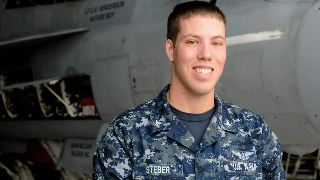 Petty Officer 3rd Class Timothy Steber is a 2009 Silver Stage High School graduate.