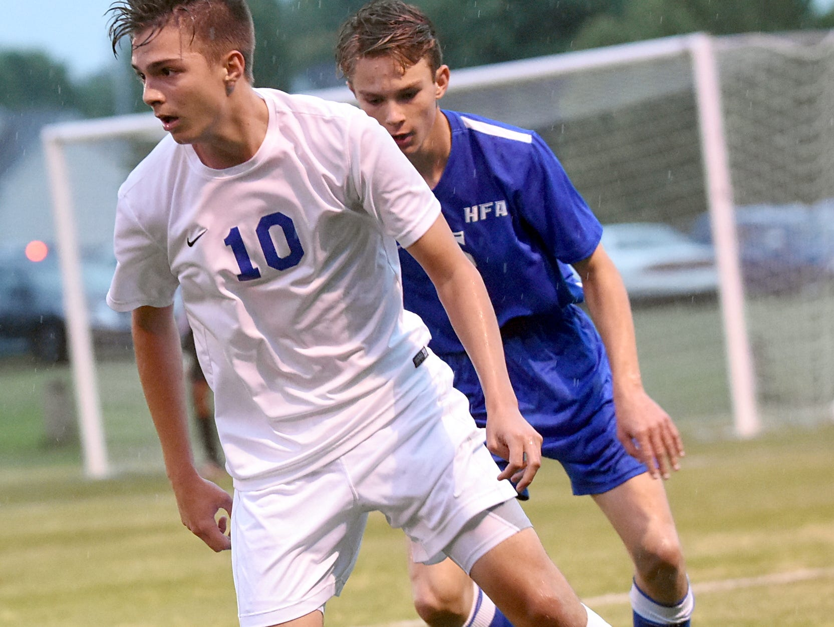 White House High junior midfielder Brady Briley maintains possession in front of Hume-Fogg sophomore Jake Peters during first-half action.