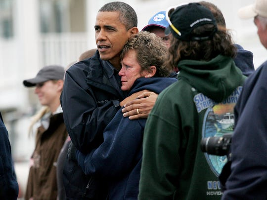 President Obama comforts Donna Vanzant, owner of the North Point Marina on East Shore Dr. in Bergentine.  Boats from the marina ended up in the street after Hurricane Sandy hit New Jersey.  Wednesday, October 31, 2012.