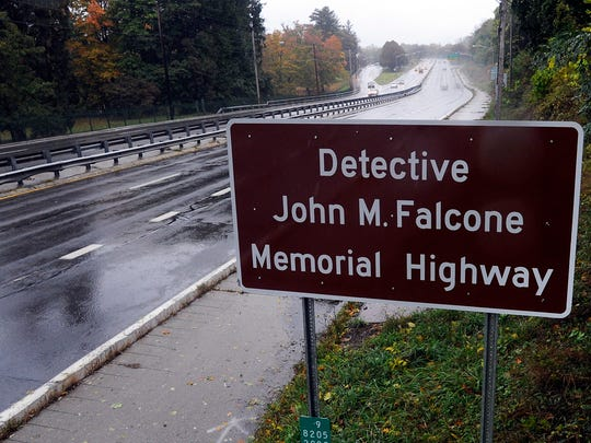 One of two signs announcing the Detective John M. Falcone Memorial Highway in the City of Poughkeepsie.