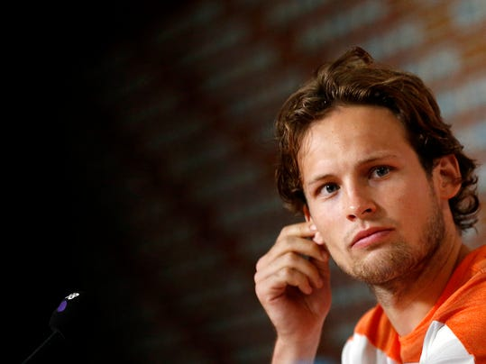 Daley Blind of the Netherlands listens to his team mate speak during a press conference after a training session in Rio de Janeiro, Brazil, Sunday, June 15, 2014. His commanding play in that match has sparked intense speculation in England that he could be playing in the red of Manchester United next season when current Netherlands coach Louis van Gaal moves to Old Trafford and attempts to rebuild the storied club after a disastrous season. (AP Photo/Wong Maye-E)