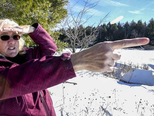 Sally Collopy, who lives on Fairfield Pond in Fairfield, is opposed to having 7 nearly-500 foot high wind turbines built on a hill overlooking the pond.  Seen on Friday, January 22, 2016.