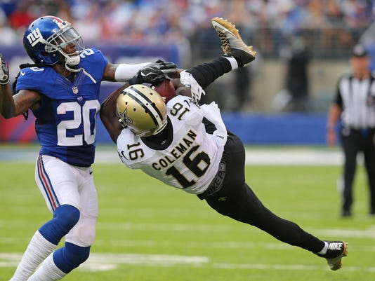 New Orleans Saints wide receiver Brandon Coleman is defended by New York Giants' Janoris Jenkins (20) during the second half of an NFL football game, Sunday, Sept. 18, 2016, in East Rutherford, N.J. The pass was incomplete on the play. (AP Photo/Seth Wenig)