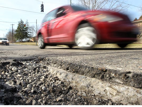 Officials expect more pothole after wild temperature swings.