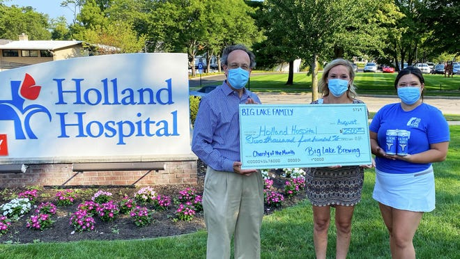 Big Lake Brewing presents a $2,500 check to representatives of Holland Hospital. The company also donated meals to the hospital during the spring as part of its effort to recognize healthcare workers during the COVID-19 pandemic.