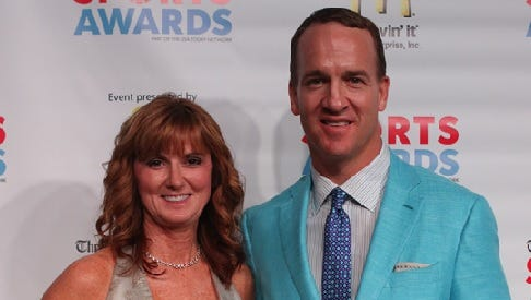 North DeSoto coach Lori McFerren poses with Peyton Manning during Monday's Times Sports Awards banquet.