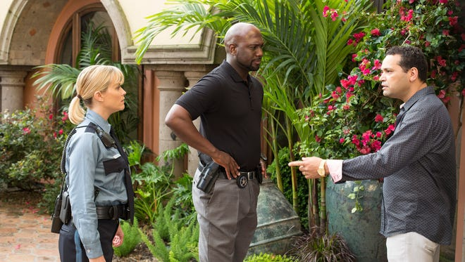 """Reese Witherspoon, Richard T. Jones and Robert Kazinsky (from left) star in """"Hot Pursuit."""""""