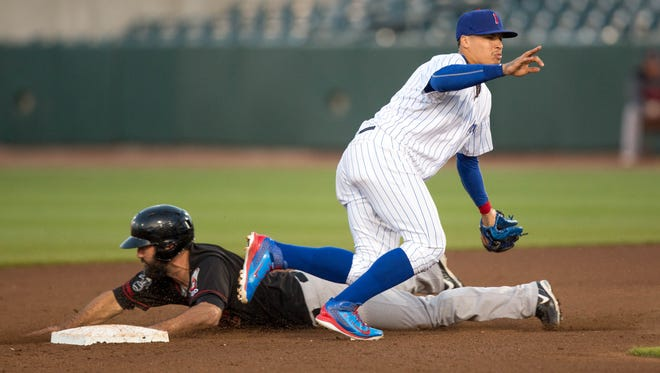 Iowa Cubs' Javy Baez (9) tries to tag out Music City's Jason Pridie (14) Tuesday, May 12, 2015, during their game at Principal Park in Des Moines.