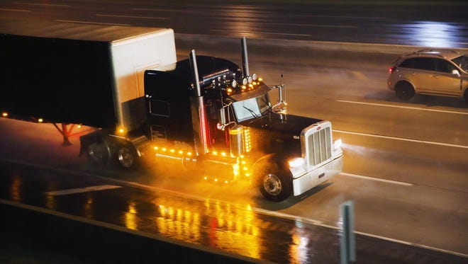 """A truck driver navigates a rain-covered highway on the outskirts of Chicago on June 10, 2014, in Hinsdale, Illinois. Legislation introduced in the U.S. Senate that would ease restrictions on the number of hours truckers can drive each week is being questioned following a crash on the New Jersey Turnpike in which an allegedly sleep-deprived truck driver crashed into a limo, seriously injuring comedian Tracy Morgan and killing Morgan's friend, fellow comedian James """"Jimmy Mack"""" McNair."""