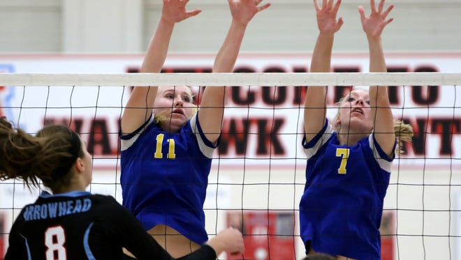Mukwonago's Maddie Bader (left), shown in a sectional semifinal match last week, led the Indians to a sectional final victory over Menomonee Falls Saturday