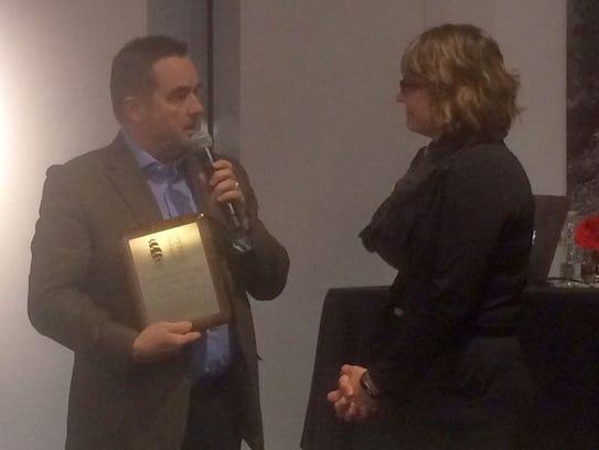 Green Bay Mayor Jim Schmitt, left, receives the Great