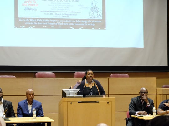 Alicia Nails, Director of the Journalism Institute for Media Diversity at Wayne State University and secretary of Detroit's NABJ chapter, welcomes guests to the university law school.