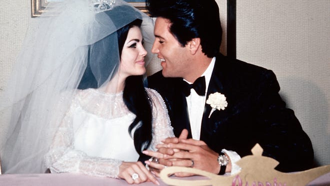 Singer Elvis Presley and his bride, the former Priscilla Beaulieu, are shown at the Aladdin Hotel in Las Vegas, Nev., after their wedding on May 1, 1967.  Presley, 32, and Beaulieu, 21, then flew to Palm Springs, Calif., for a short honeymoon.