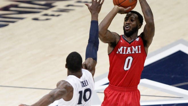 Miami RedHawks guard Geovonie McKnight (0) takes a shot from 3-point range in the first half of the NCAA men's basketball game at the Cintas Center on the campus of Xavier University in Norwood, Ohio, on Friday, Nov. 13, 2015. At the half, Xavier led 45-40 over Miami.