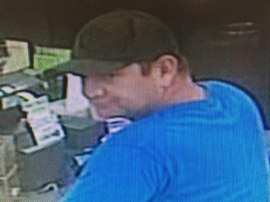 Detectives were at the scene of the 7-11 at Dixon and Fiske boulevards, where a suspect displayed a firearm under his shirt and demanded money.
