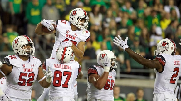Sep 26, 2015; Eugene, OR, USA; Utah Utes tight end Caleb Repp (47) celebrates a touchdown with offensive tackle Sam Tevi (52) and tight end Siale Fakailoatonga (87) and offensive lineman Siaosi Aiono (60) and wide receiver Kenneth Scott (2) against the Oregon Ducks at Autzen Stadium. Mandatory Credit: Scott Olmos-USA TODAY Sports