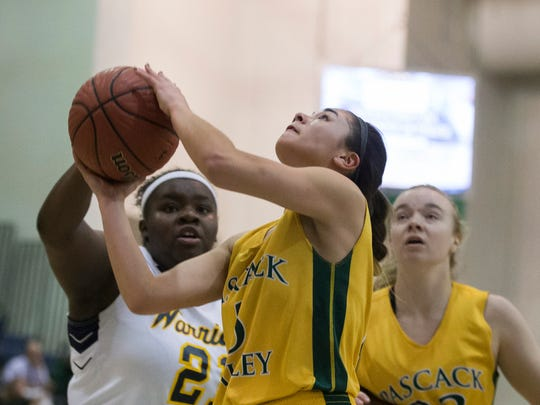Pascack Valley's Brianna Wong goes up with a shot as