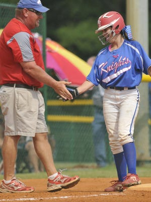 Glynn Lott, left, Macon East coach, congratulates Paxton Searle (18) after her hit put her on third base during their AISA Class AAA softball championship game with Glenwood at Lagoon Park on Saturday, May 5, 2012, in Montgomery, Ala.. (Lloyd Gallman/Advertiser)