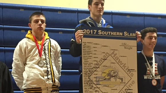 Eastside's Riley Augustine, left, stands on the podium next to champion Nick Masters of Woodward (Ga.) Academy Saturday after taking second in the 120-pound weight class in the Southen Slam wrestling tournament at Eastside.