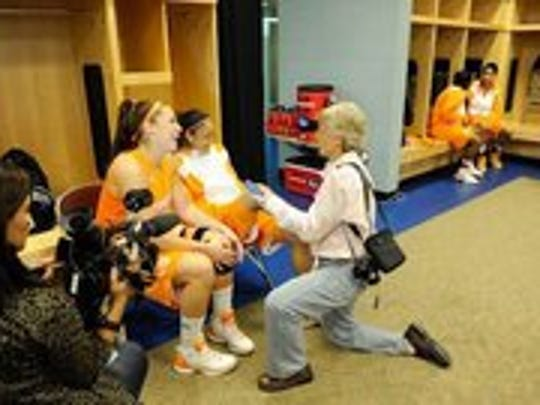 Courtesy of NCAA Women's Basketball. Maria M. Cornelius interviews Lady Vols Taber Spani and Meighan Simmons in Des Moines, Iowa, where Pat Summitt coached her last game. Cornelius has written a book about the 2011-12 season.