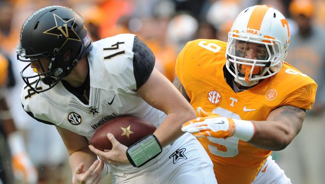 Tennessee defensive end Derek Barnett, right, chases down Vanderbilt quarterback Kyle Shurmur during the first half of a game in 2015 at Neyland Stadium.
