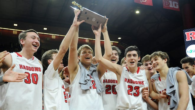 Haddonfield celebrates after defeating Newark Central 62-45 in the Group 2 state final at Rutgers University.