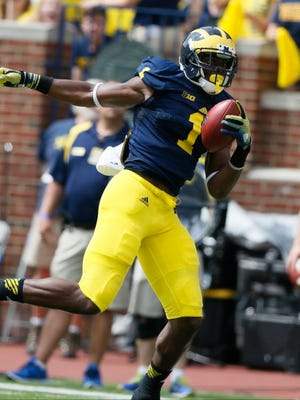 Michiganwide receiver Devin Funchess catches a pass that he runs into the enzone for his second touchdown and a 14-0 lead over Appalachian State in their football game in Ann Arbor on Saturday, August 30, 2014.