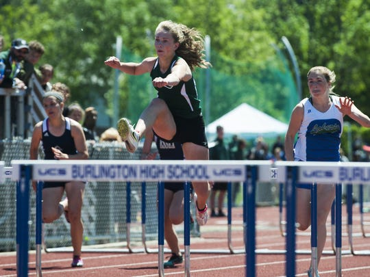 St. Johnsbury's Katherine Cowan leaps over a hurdle in first place during the girls 100m hurdle race during the high school track and field state championship meet at Burlington High School on Saturday June 6, 2015 in Burlington, Vermont. (BRIAN JENKINS/for the FREE PRESS)